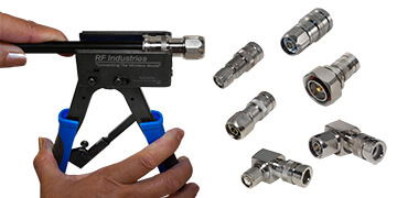 a hand squeezing a compression tool, putting a connector on a cable